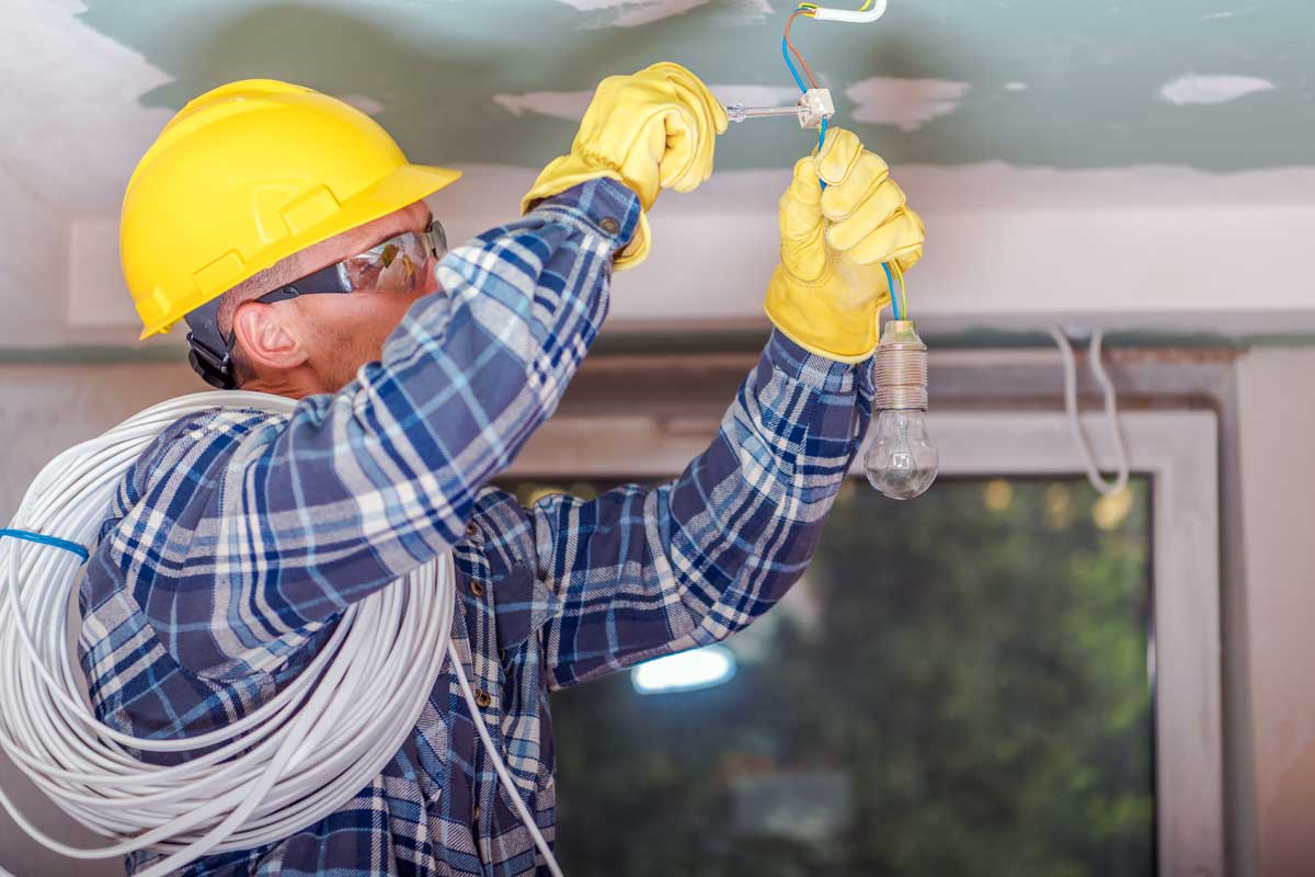 Electrician Fixing Light